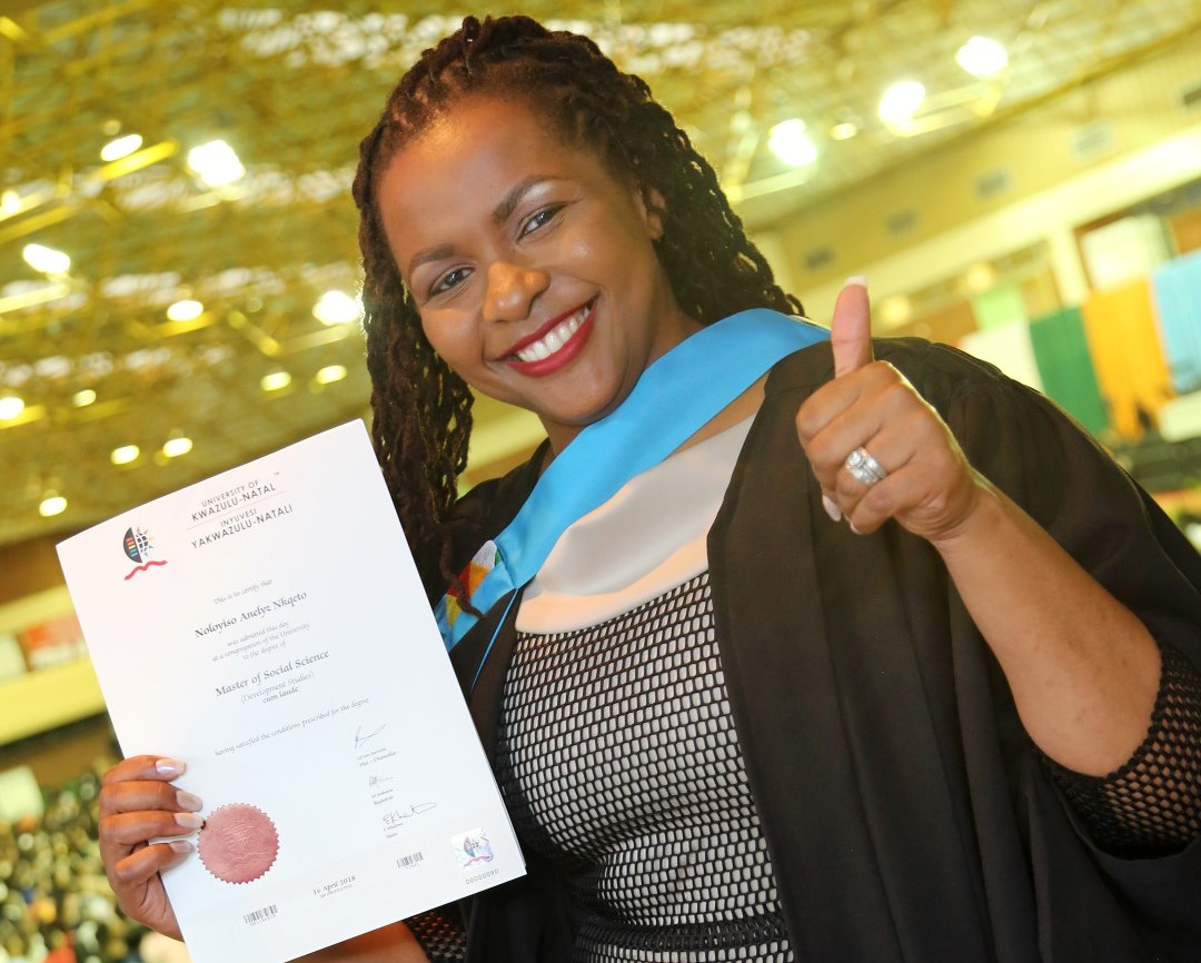 Mrs Noloyiso Walingo graduates cum laude with her Masters in Development Studies.